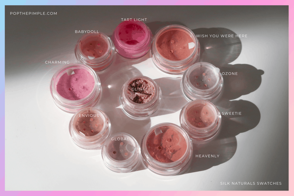 """Silk Naturals Blush Acidly Bright, Silk Naturals Blush I wish you were here, Silk Naturals Ozone, Silk Naturals Sweet Highlighter, Silk Naturals Heavenly Blush, Silk Naturals Global, Silk Naturals Envious, Silk Naturals Enchanting Blush, Silk Naturals Babydoll Blush """"width ="""" 1023 """"height ="""" 682 """"/> </p> <h3> Heavenly </h3> <p> This is a brownish peach color that can be used for more brownish looks than blush or on the eyelid as my preference. It really bursts the blues of my eyes. </p> <p> Conversely, in my opinion it can also be used as a highlighter on darker skin tones. </p> <p> Entertaining fact: This is a scam for MAC's Stereo Rose Mineralize Skin Finish. </p> <h3> Global </h3> <p> This shimmering peach hue is a really beautiful blush / highlighter, but it is another that I forget. There is literally nothing wrong with it, boiling is spectacular and refined, but other colors seem to be in the spotlight for my purposes. </p> <p> Again, I would like to hear how you would use this shade! </p> <h3> Envious </h3> <p> I prefer this shade for my eyelids over my face because it is a very intense, sparkling / shimmering duochrome. It's one of the most sparkling shades of them all (see photo below). This is another color that I don't resort to often just because there isn't enough space on my face to use all of those colors. </p> <p> But I still LOVE this beautiful shade. I can watch it all day! Tell me how you used it when you tried it! 🙂 </p> <p> <img class="""